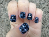 Haunted Mansion wallpaper nails.