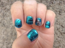 Manatees and water marbling combine in these nails honouring The Living Seas attraction at Epcot.